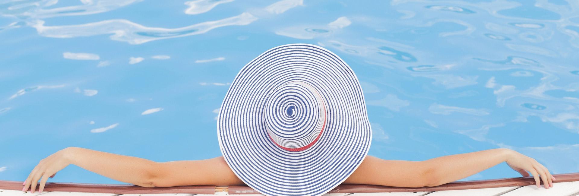 inground-swimming-pool-lady-in-hat